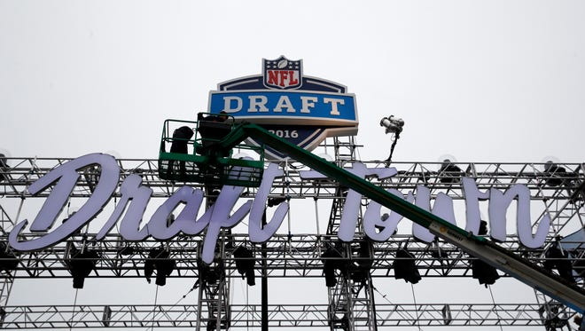 Workers prepare for NFL's  Draft Town at Grant Park, Wednesday, April 27, 2016, in Chicago before Thursday's first round of NFL football draft.