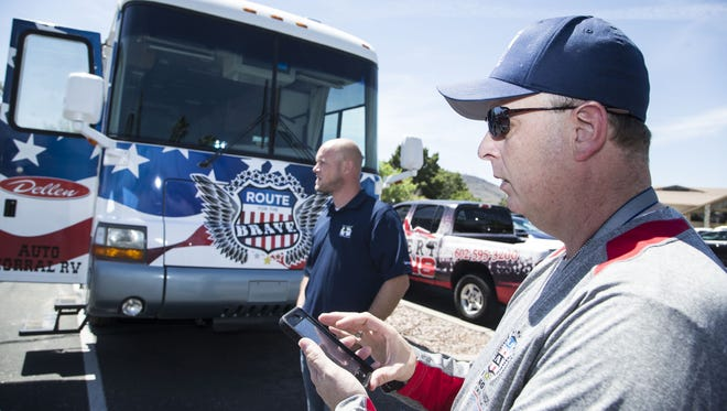 Darin Fishburn (right), CEO of Helping Hands for Freedom, and Nicholas Schaus meet at Moon Valley Country Club in Phoenix to prepare for the group's Route for the Brave campaign, a 3,100-mile walk across America to gain support for veterans and their families.