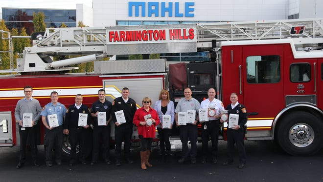 York Heiliger, MAHLE HR manager (from left), Andrew Staub, paid on call firefighter/EMT, Lee Panoushek, deputy chief, Alexander Bradford, firefighter/paramedic, Jason Olszewski, fire marshal, Annie Kushner, MAHLE EHS coordinator, Amira Lewis, secretary to the fire marshal, Jarod Foshag, sergeant/paramedic, staff Lt. James Neufeld and staff Lt. Larry Gauthier.