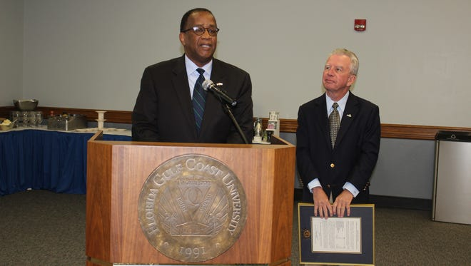 Florida Gulf Coast University Board of Trustees Chairman Dudley Goodlette (right) stands next to President Wilson Bradshaw on Tuesday as Bradshaw is honored for his 10 years of leadership at the school. Bradshaw is stepping down June 30.