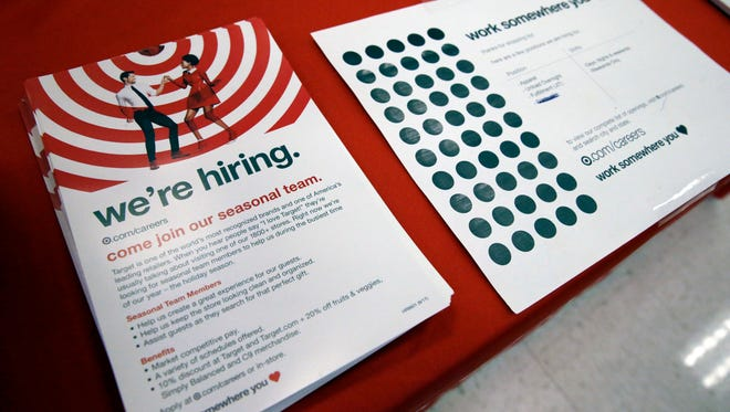 In this Sunday, Oct. 15, 2017, photo, information on available jobs lies on display at a Target store in Chicago. On Tuesday, Nov. 7, 2017, the Labor Department reports on job openings and labor turnover for September.