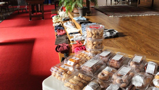 Donated pastries and clothing wait to be scooped up by patrons in the First Presbyterian Church in Wausau.