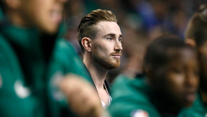 Boston Celtics' Gordon Hayward watches from behind the bench during the first quarter of an NBA basketball game against the Golden State Warriors in Boston, Thursday, Nov. 16, 2017.