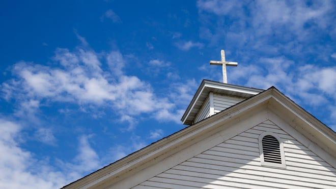 Church cross and steeple.