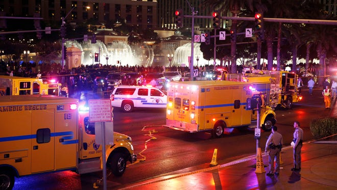 Police and emergency crews respond to the scene of a car accident along Las Vegas Boulevard, Sunday, Dec. 20, 2015, in Las Vegas.