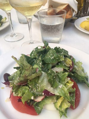 The house salad at Campiello is a robust mix of greens and lots of add-ons.