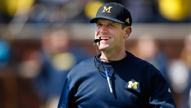 Michigan football coach Jim Harbaugh looks on during the spring game April 4, 2015, at Michigan Stadium in Ann Arbor.