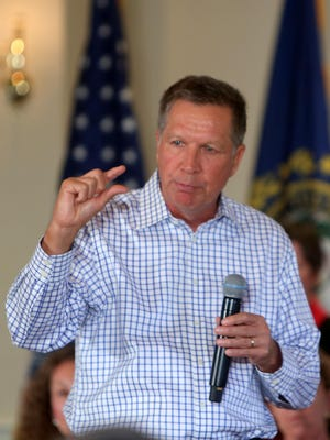 Gov. John Kasich speaks to a crowd at a town hall-style meeting Wednesday at the Portsmouth Country Club in New Hampshire.