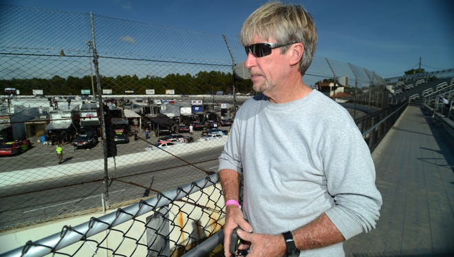 Tim Bryant, Five Flags Speedway General Manager, looks over the track as cars take laps during practice Thursday in preparation for this weekend's 47th Annual Snowball Derby.