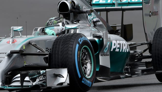 Nico Rosberg of Mercedes drives his car to qualify in the pole position for Sunday's British Grand Prix.