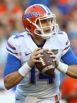 Florida Gators quarterback Luke Del Rio (14) looks to pass in the first quarter of the Orange and Blue at Ben Hill Griffin Stadium.