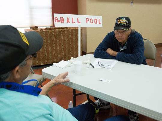 Charles Gardner, right, and Art Candelaria, sit chatting after registering for the 8-ball pool events at the Doña Ana County Senior Olympics, Saturday February 18, 2017, at the Trail West Clubhouse.