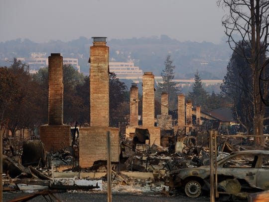 In this Oct. 13 file photo, a row of chimneys stands in a neighborhood devastated by a wildfire near Santa Rosa.