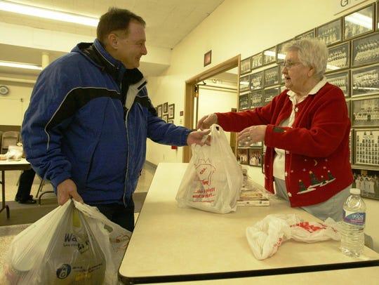 Jay Miller receives donated flatbread from volunteer