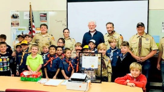 Ruidoso Village Councilor Lynn Crawford, center, was recognized for his community service and his support of the Webelos den.