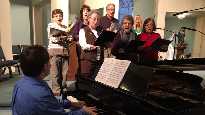 The Annandale Reformed Church choir rehearses for its first appearance in the upcoming interfaith concert.