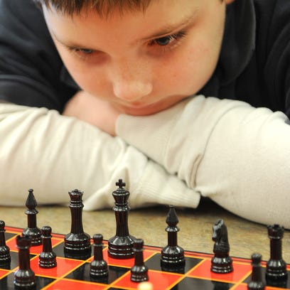 Keenan Foust, 10, strategizes his next chess move against