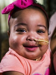 Malaya Soares, 10 months, smiles at home on March 7,