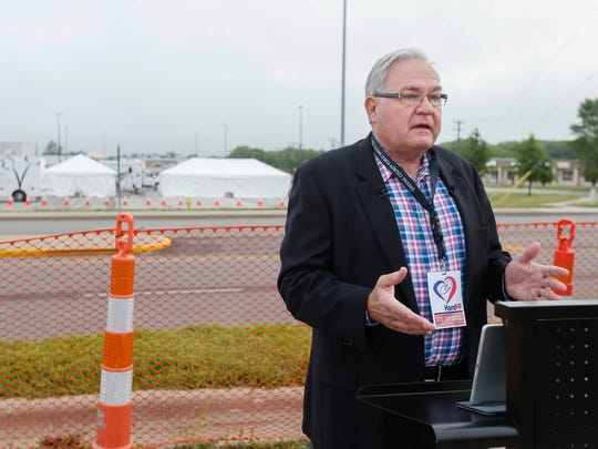 Jim O'Neal, former mayor and member of the Ozarks Alliance to End Homelessness, gives a press briefing outside of the multi-agency response center that is set up in the Walmart parking lot on Kearney Street on Monday, June 5, 2017. The response center is set up to help the homeless who live in a camp near the area to receive services.