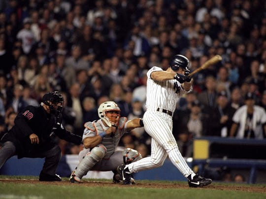 Tino Martinez of the New York Yankees hits a grand slam during the 1998 World Series Game 1 against the San Diego Padres at the Yankee Stadium in New York.