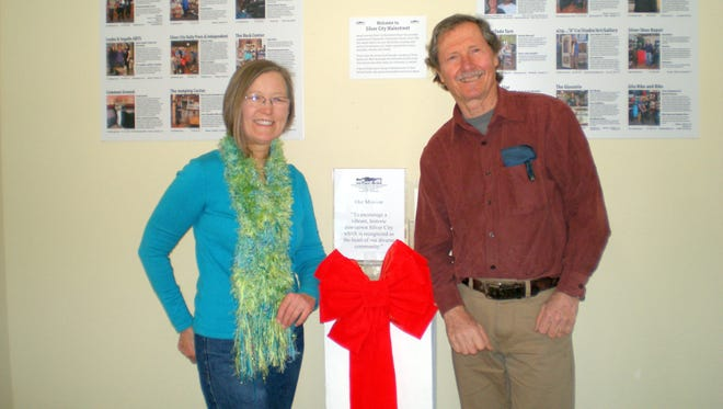 Pictured are Rebecca Martin and George Austin in front of part of the exhibit.
