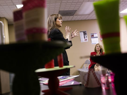 Kim Dwyer of Novi listens as Mary Kay Independent Sales Director Lori Morgan talks with some of her recruits about upcoming events and products during a meeting on Monday, Oct. 5, 2015, at the Mary Kay Training Center in Livonia.