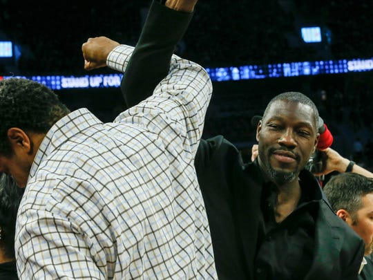 Pistons great Ben Wallace links arms with former teammate Rasheed Wallace before the Pistons' win over the Warriors Saturday at the Palace.