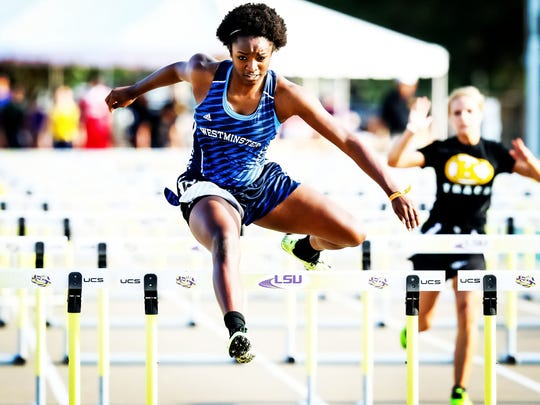Mike Curley, Special to the Daily World Westminster?s Ivy Cains wins the 100 hurdles at the Class 2A state track meet Friday in Baton Rouge.