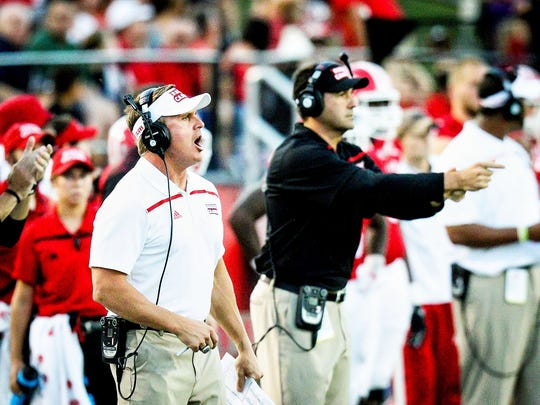 Offensive coordinator Jorge Munoz, right, enjoyed his best night of the season, leading the Cajuns to a 33-26 road win over Georgia Southern.