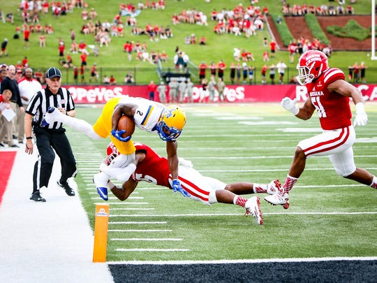 UL safety Travis Crawford lays out to to prevent  McNeese State receiver Darious Crawley from reaching the end zone earlier this season.