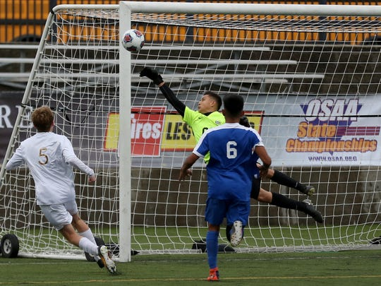 Woodburn's Jose Ochoa (00) makes a save in the Woodburn vs. Corvallis OSAA Class 5A championship boys soccer match at Hillsboro Stadium on Saturday, Nov. 11, 2017. Woodburn won the championship 2-1 in overtime.