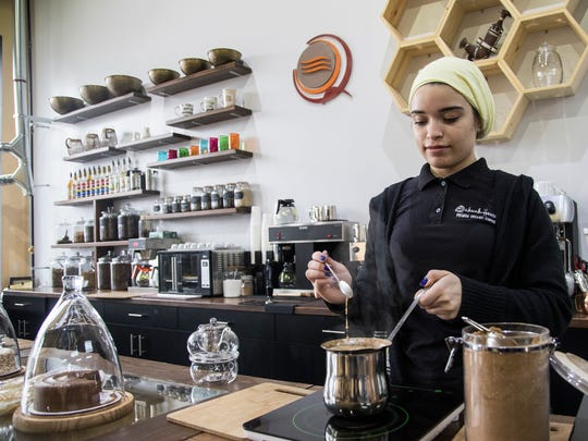 Coffee shop worker Lina Yaseen prepares a pot of Jubani, a Yemeni style coffee with light roast coffee and husks served with cardamom, ginger and cinnamon at the Qahwah House in Dearborn, Thursday, January 11, 2018.