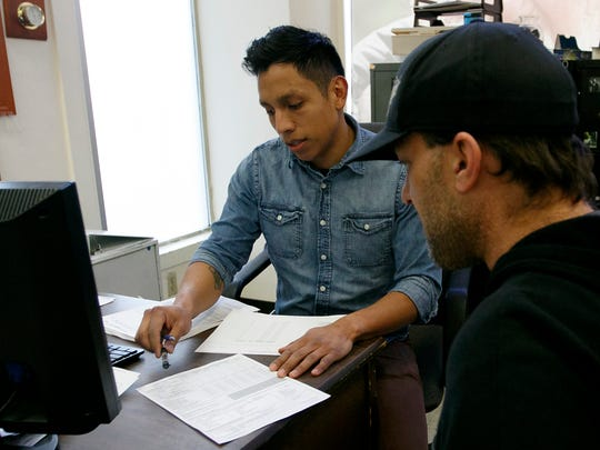 Moises Ramos, 28, helps Jason Kistner file paperwork for the Point-in-Time homeless count at the Union Gospel Mission men's shelter in Salem on Wednesday, Jan. 31, 2018. Ramos was one of 10 UGM staff members who conducted the mission's portion of the Point-in-Time homeless count.