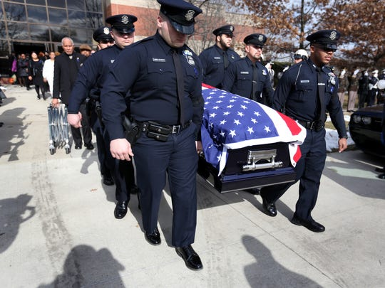 Pallbearers Police Officer Samuel Anderson, Police Officer Hussain Al-Omari, Police Officer Marchelloe Brown, Police Officer Joseph Lennis-Saunders, Police Officer Angel Bermudez, and Police Officer Elvedin Abdijanovic carry the casket of fallen Detroit Police Officer Glenn Anthony Christopher Doss out to the hearse after his funeral at Greater Grace Temple in Detroit on Friday, Feb. 2, 2018.