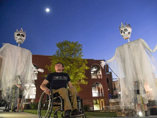 Ben Otto Sunderman, middle, is surrounded by ghosts