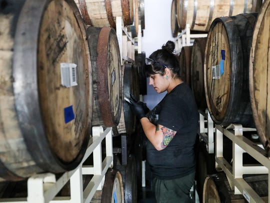 Brewer and and Barrel Manager Alexis Jorgensen locates
