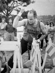 In an old publicity photo, Patrick Wrenn breaks boards