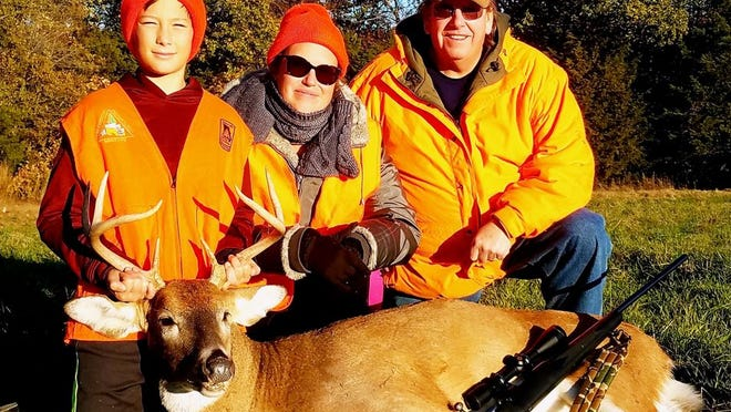 MDC reminds young hunters the early portion of firearms youth deer season runs Oct. 31 - Nov. 1. During last year's portion, first-time deer hunter Troy Fox (left) harvested his first buck during a mentored hunt in Columbia. He's pictured with his mom Meridithe Greene and hunting mentor Terry Pollard.