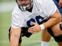Penn State center Angelo Mangiro runs a drill during practice on Thursday (Abby Drey/Centre Daily Times via AP)