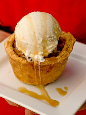 Pastry Chef Katie Sansone of Tom's Thumb Market created the Do-si-dos Apple Pie using Girl Scout cookies.