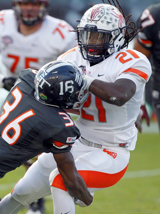American team running back Jacobi Green (21), of Richmond, scores a 4-yard touchdown against National team defensive back Antonio Glover (36), of Georgia Southern ,during the first half of the NFLPA Collegiate Bowl football game in Carson, Calif., Saturday, Jan. 23, 2016. (AP Photo/Alex Gallardo)