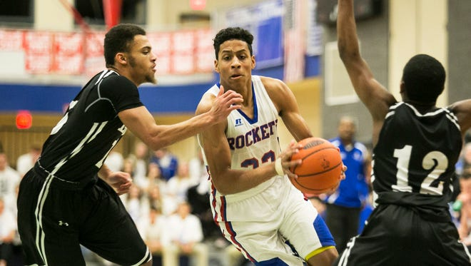 Spring Grove's Eli Brooks, center, scored a career-high 40 points to lead the Rockets to a 79-77 win over previously unbeaten Middletown on Wednesday night. Amanda J. Cain photo