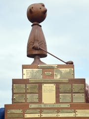 "A wood carving of the iconic ""Peanuts"" character Charlie Brown tops the Charlie Brown Invitational trophy, which bears the names of the winners, those who made holes-in-ones and those who have died since the the ""Charlie Browners"" golfing group was established in 1970."
