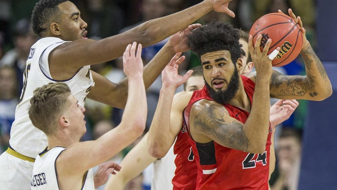 FILE -- Ball State's Trey Moses gets pressure from Notre Dame's Bonzie Colson, left, and Rex Pflueger during the second half of an NCAA college basketball game Tuesday in South Bend. Ball State beat Notre Dame 80-77.