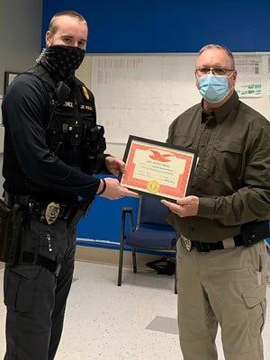 El Dorado Police Sergeant Sean McCormick a was presented a life saving medal by Police Chief Kurt Zieman.
