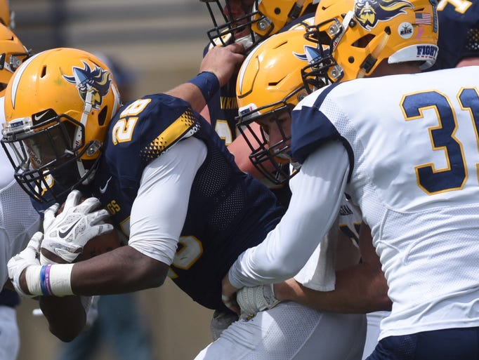 Augustana University's Rudy Sinflorant tries to escape
