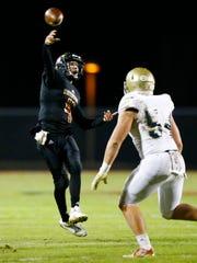 Ravenwood quarterback Brian Garcia throws to a receiver