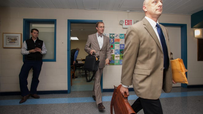 South Burlington School Board members walk out of executive session Wednesday night in South Burlington.