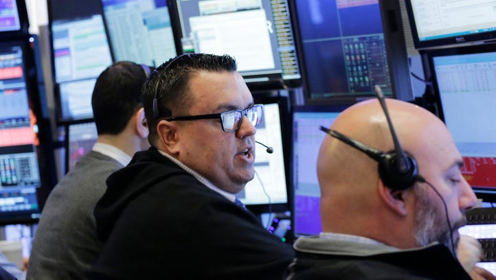 Stock traders work at the New York Stock Exchange.