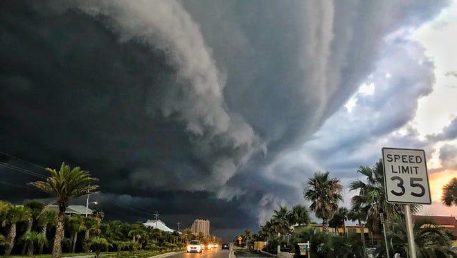 A photo shot by Sean Rogan depicts swirling, menacing clouds overlooking Via de Luna Drive at Pensacola Beach.